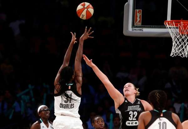 The New York Liberty's Tina Charles shoots against
