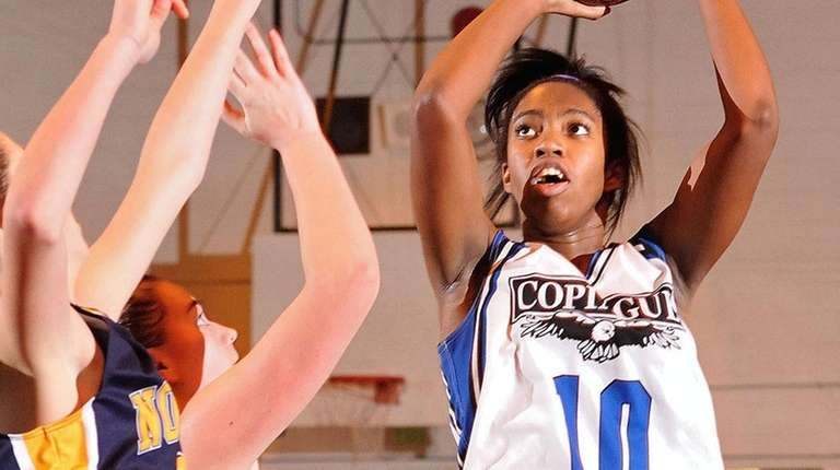 Mikaiya Moore of Copiague shoots a jumper during