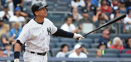 New York Yankees designated hitter Alex Rodriguez watches
