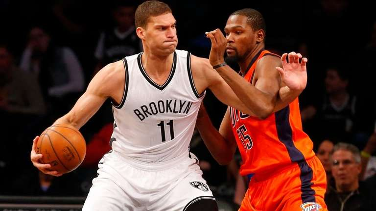 Brook Lopez of the Brooklyn Nets controls the
