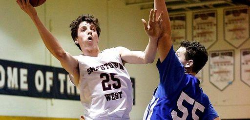 Smithtown West's Kyle LaGuardia scores a layup around