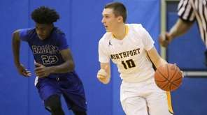 Northport's Sean O'Shea, right, dribbles up court past
