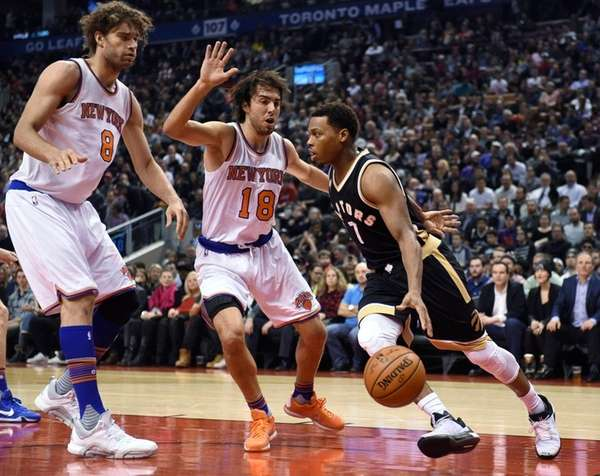 Toronto Raptors' Kyle Lowry drives toward Knicks' Sasha
