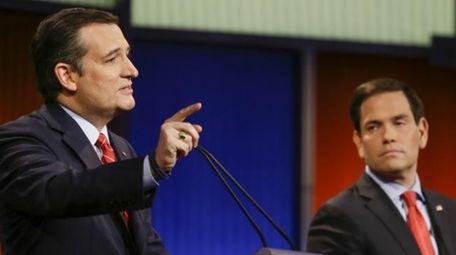 Republican presidential candidate Sen. Ted Cruz, R-Texas, answers