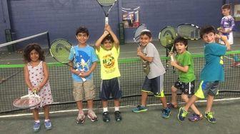 Kids learn tennis at Camp Gan Israel in
