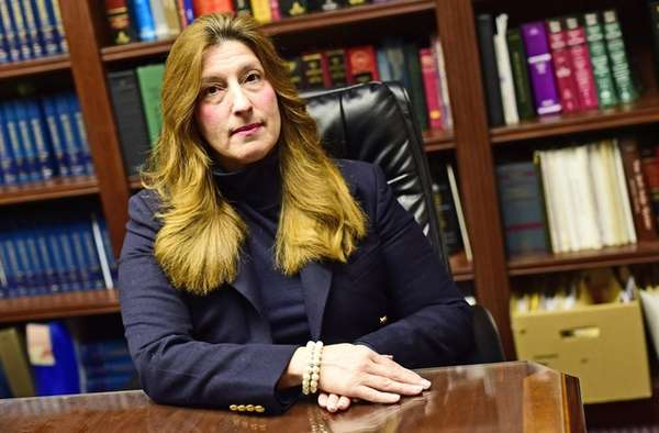 Angela Bianco in the Mineola office of her