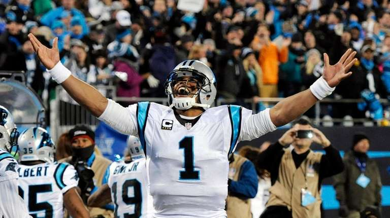 Carolina Panthers' Cam Newton celebrates Ted Ginn's run