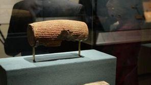 The Cyrus Cylinder (top), Achaemenid, 539-538 B.C., excavated