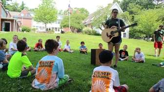 Campers learn and sing songs together at Harbor