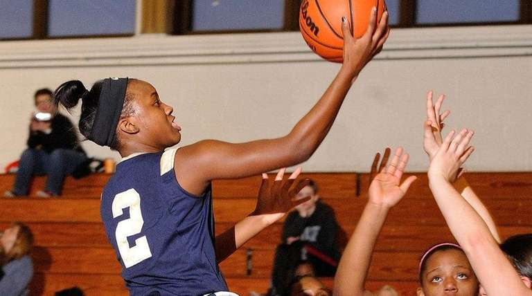 Aziah Hudson of Baldwin looks to drive to