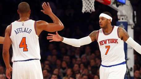 Carmelo Anthony #7 and Arron Afflalo #4 of