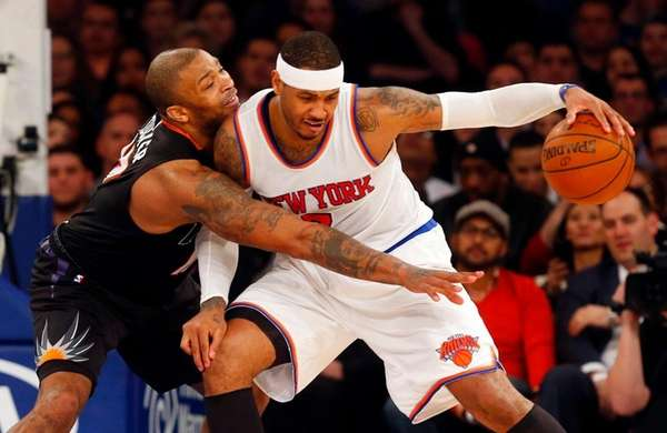 Knicks' Carmelo Anthony controls the ball against P.J.