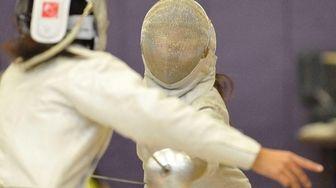 Elin Hu of Manhasset, right, battles Shannon Sarker