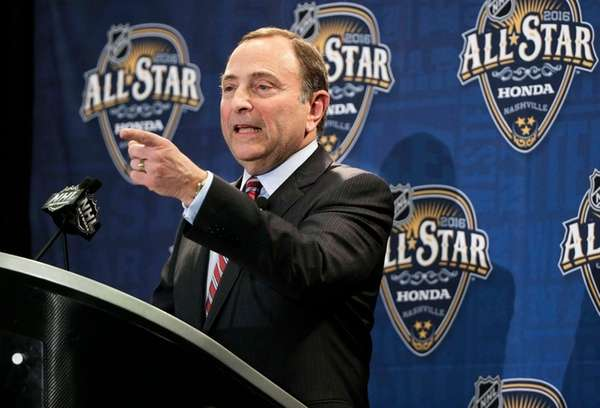 NHL commissioner Gary Bettman takes a question during