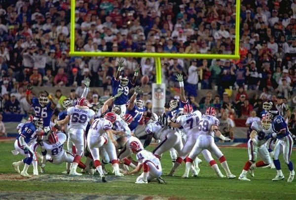 Buffalo Bills kicker Scott Norwood, center, misses the