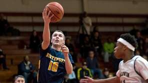 Baldwin's Shane Gatling defends as Northport's Sean O'Shea