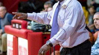 Baldwin head coach Darius Burton looks on during
