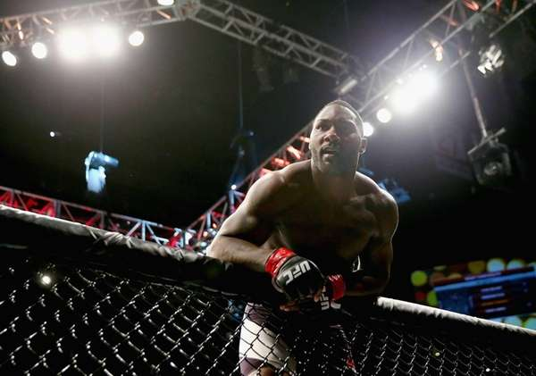 Anthony Johnson celebrates his win by TKO against