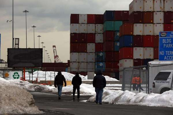 Shipping containers are stacked at the Port of