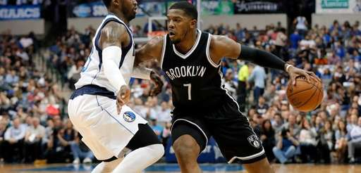 The Nets' Joe Johnson, right, in his 15th