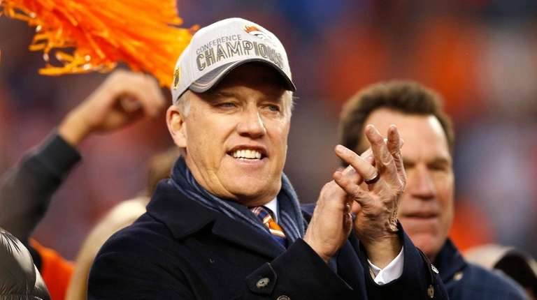Denver Broncos general manager John Elway celebrates after
