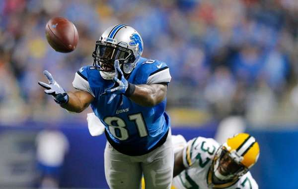 Detroit Lions wide receiver Calvin Johnson stretches but