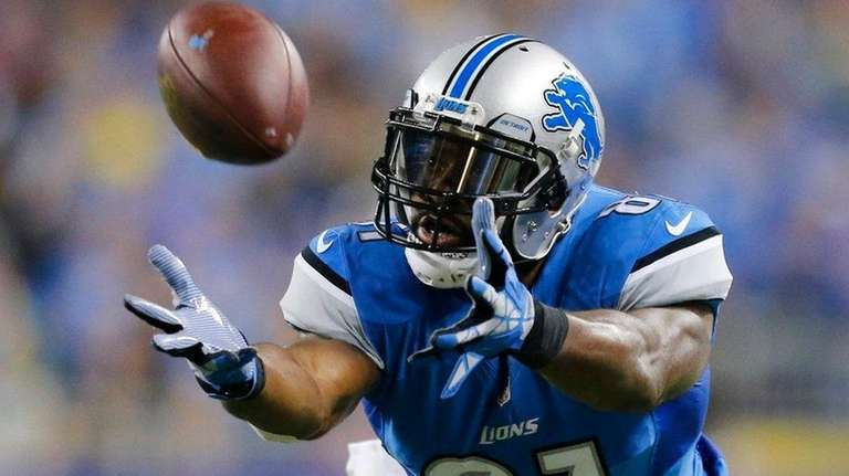 Detroit Lions wide receiver Calvin Johnson stretches but