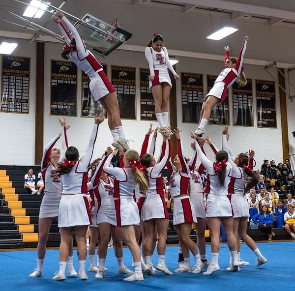 Smithtown East's cheerleaders perform at Sachem North High