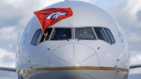 The plane carrying the Denver Broncos arrives at