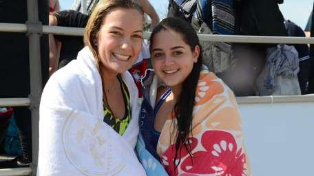 Charlotte Lathrop, left, with friend Michaela Asaro, thrashed
