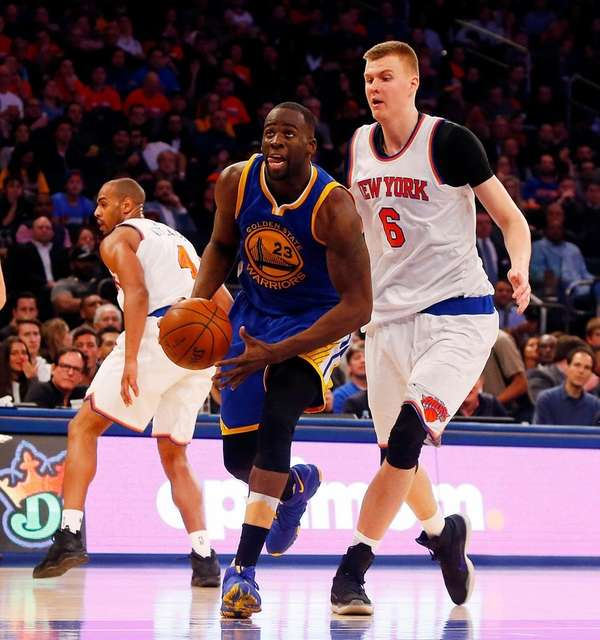 Draymond Green of the Golden State Warriors drives