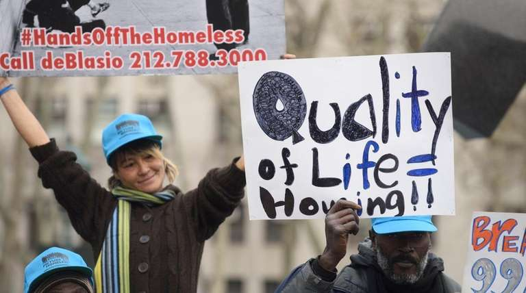Homeless New Yorkers, advocates and supporters hold a