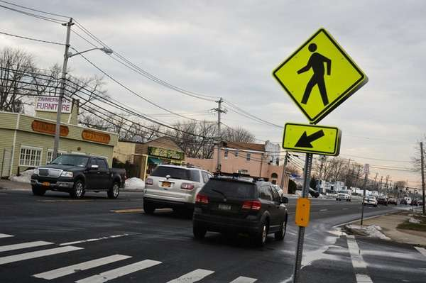 Cars drive down Montauk Highway near S. 13th