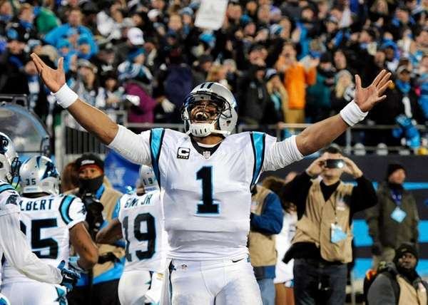 Panthers quarterback Cam Newton celebrates Ted Ginn's run
