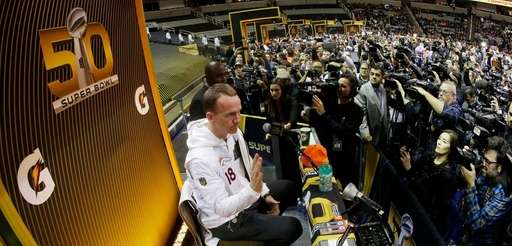 Denver Broncos quarterback Peyton Manning speaks to the