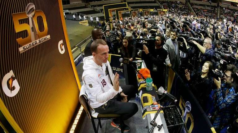 Denver Broncos quarterback Peyton Manning speaks to the
