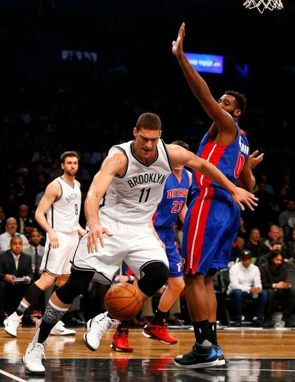 Brook Lopez of the Brooklyn Nets tries to