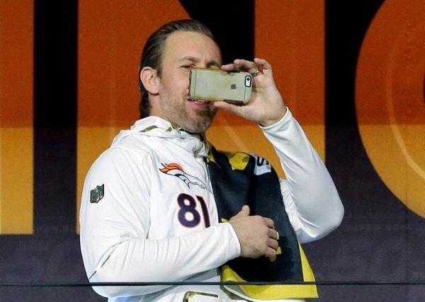 Denver Broncos' Owen Daniels takes pictures as