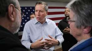 John Kasich talks to people who attended a