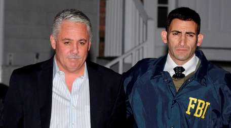 Ex-Suffolk Police Chief James Burke is arrested at