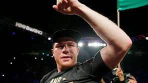 Canelo Alvarez reacts after defeating Miguel Cotto
