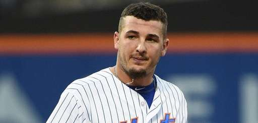 New York Mets leftfielder Darrell Ceciliani looks on