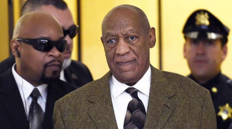 Actor and comedian Bill Cosby, center, arrives for
