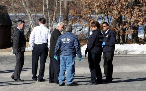 Investigators at the site where a body was