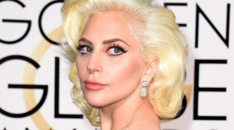 Lady Gaga arrives for the 73nd annual Golden