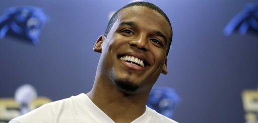 Carolina Panthers quarterback Cam Newton smiles as he