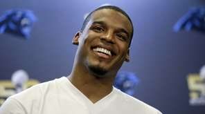 Carolina Panthers quarterback Cam Newton smiles as he