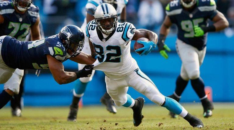 Jerricho Cotchery of the Carolina Panthers runs the
