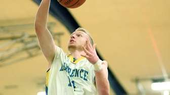 Lawrence's Sammy Robinson goes for a layup during