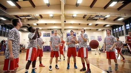Southold players warm up under the basket at
